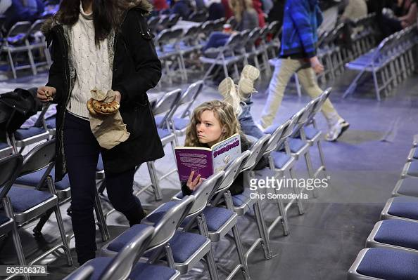 A young woman reads 'The Cartoon Guide to Statistics' while waiting for Republican presidential candidate Donald Trump to deliver the convocation at...