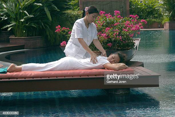 A young woman receives a Thai massage at Aspara Spa at the Plaza Athenee Hotel in downtown Bangkok The spa is unique in that guests can enjoy...