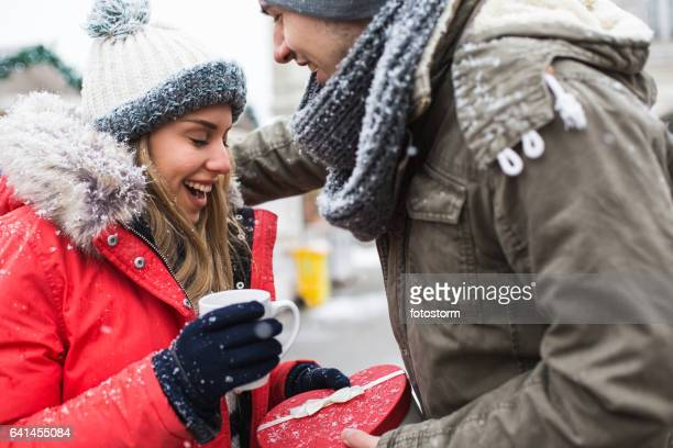 Young woman receives present on Christmas market
