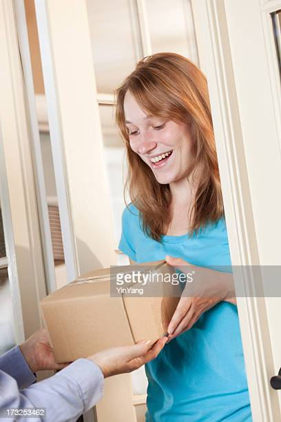 Young Woman Receiving a Package from Delivery Service Vt