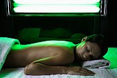 Young woman receiving light therapy