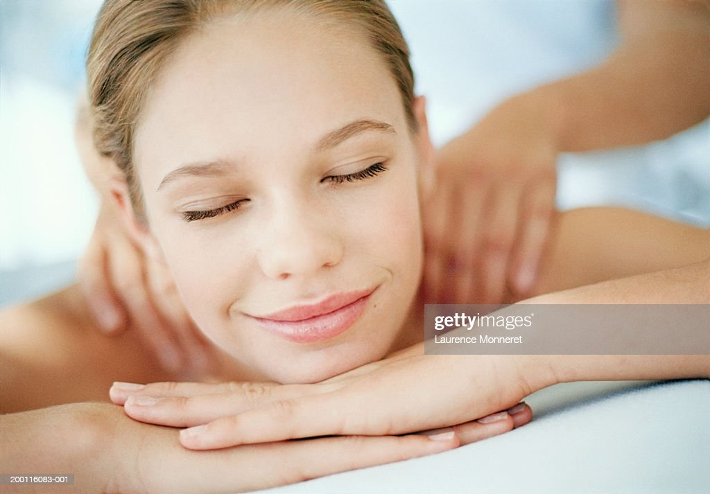 Young woman receiving massage, eyes closed, close-up : Stock Photo