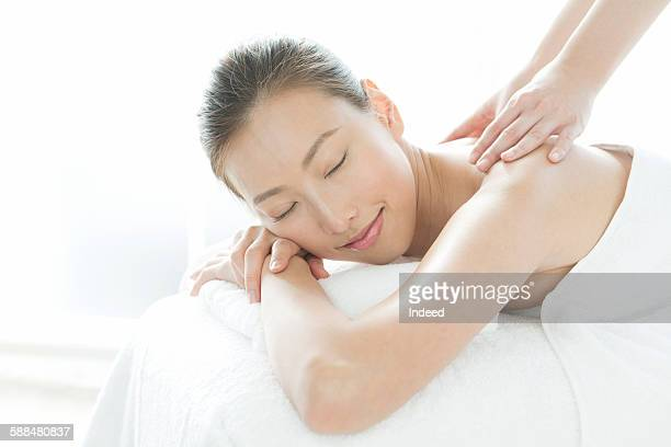 Young woman receiving massage