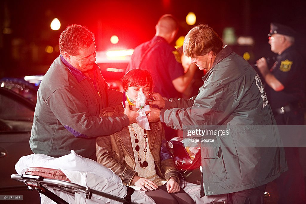 Young woman receiving medical treatment : Stock Photo