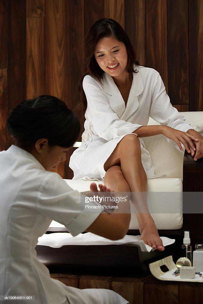 Young woman receiving pedicure : Stock Photo
