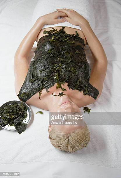 Young Woman Receiving Seaweed Treatment
