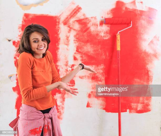 Young woman redecorating  and having problems