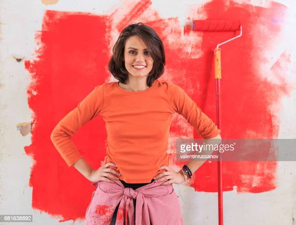 Young woman redecorating