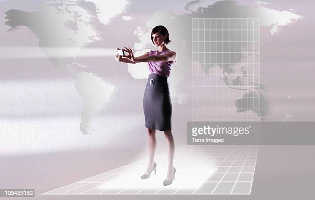 Young woman reflecting bright light by world map