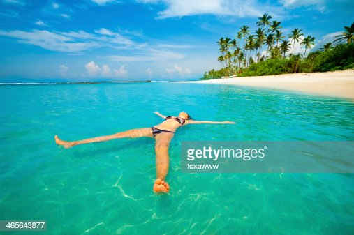 Young woman relax like a sea star : Stock Photo