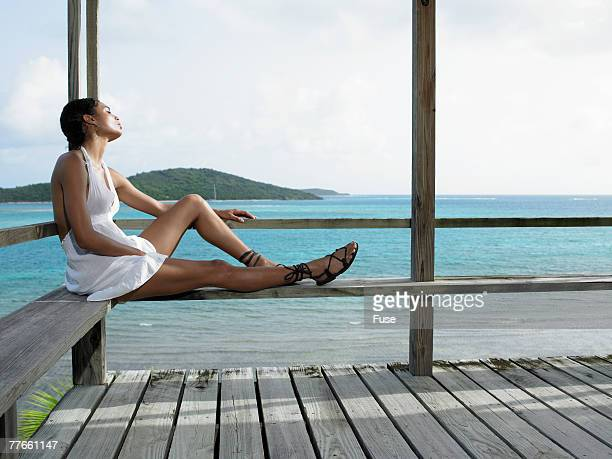 Young Woman Relaxing at Beach House