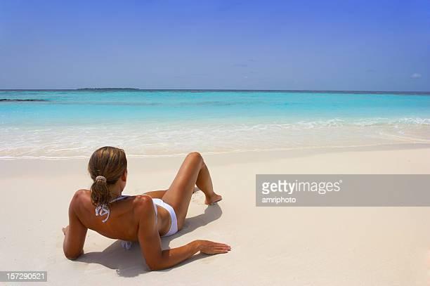 young woman relaxing beach