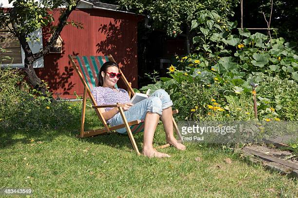 Young woman relaxing in a garden
