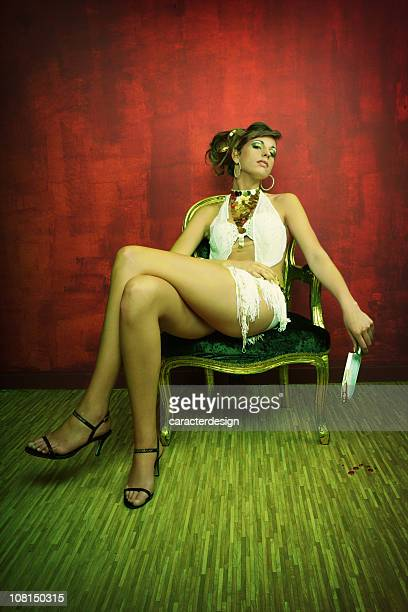 Young Woman Relaxing in Chair and Holding a Bloody Knife