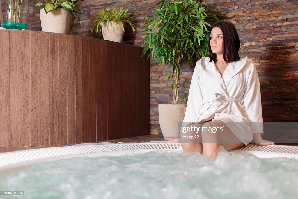 Young woman relaxing in the hot tub : Stock Photo