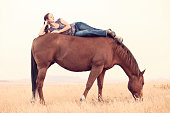 Young Woman Relaxing On Horse Back Montana Prairie
