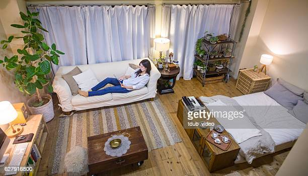 Young woman relaxing on the sofa using a digital tablet