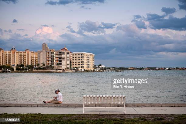 Young woman relaxing on the waterfront