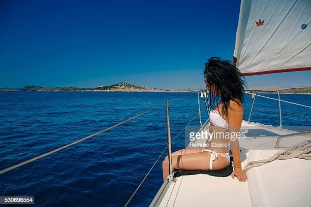 Young woman relaxing on yacht, Dugi Otok, Dalmatia, Croatia