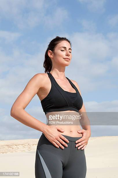 Young Woman Relaxing With Hand On Belly