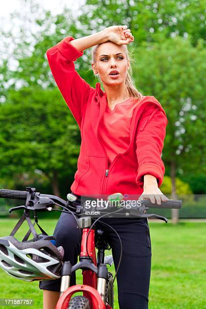 Young woman resting after bicycling