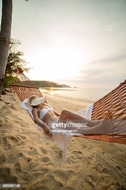 Young woman resting on hammock-Beach