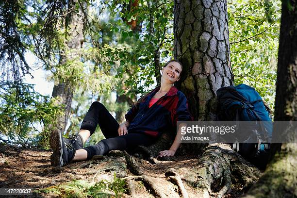 Young woman resting under tree