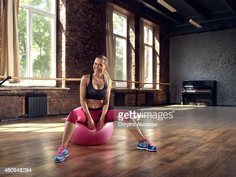 Young woman rests after fitness training