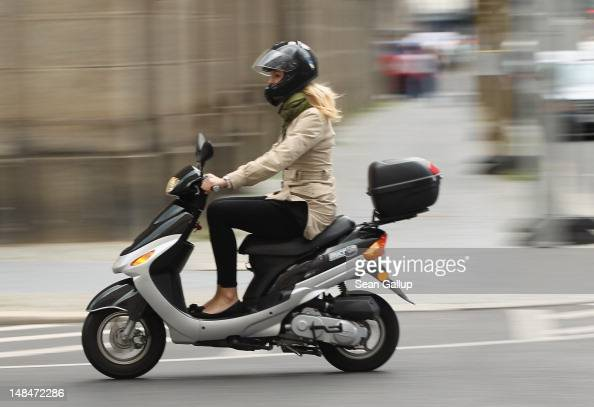 http://media.gettyimages.com/photos/young-woman-rides-a-moped-on-july-17-2012-in-berlin-germany-mopeds-a-picture-id148472286?s=594x594