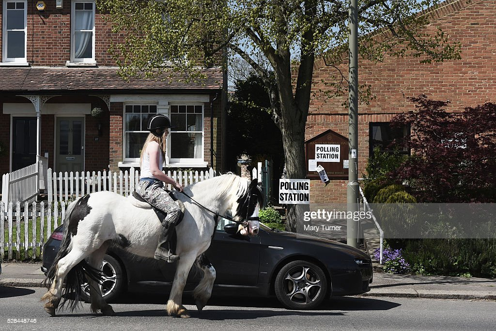 A young woman rides her horse past a polling station in Chipping Barnet, North London where a large number have been unable to vote due to registration problems at polling stations across the borough, on May 5th 2015 in London, United Kingdom. Today, dubbed 'Super Thursday', sees the British public vote in countrywide elections to choose members for the Scottish Parliament, the Welsh Assembly, the Northern Ireland Assembly, Local Councils, a new London Mayor and Police and Crime Commissioners. There are around 45 million registered voters in the UK and polling stations open from 7am until 10pm.