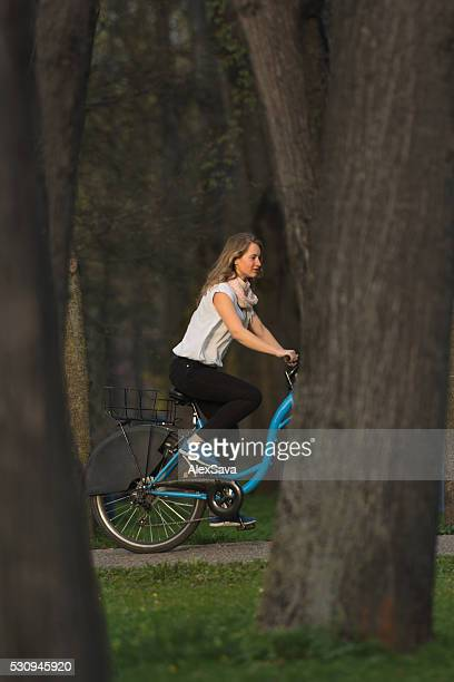 Young woman riding her bike in the park