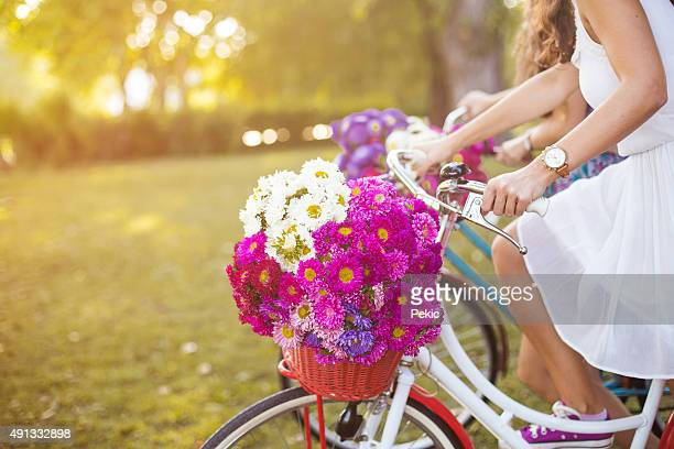 Young woman riding her white retro hipster bike