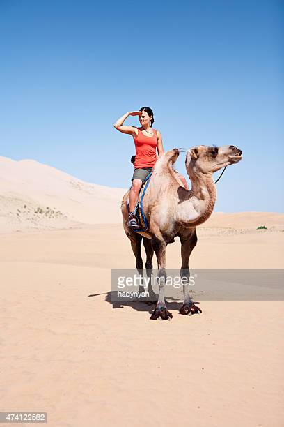 Young woman riding on the camel
