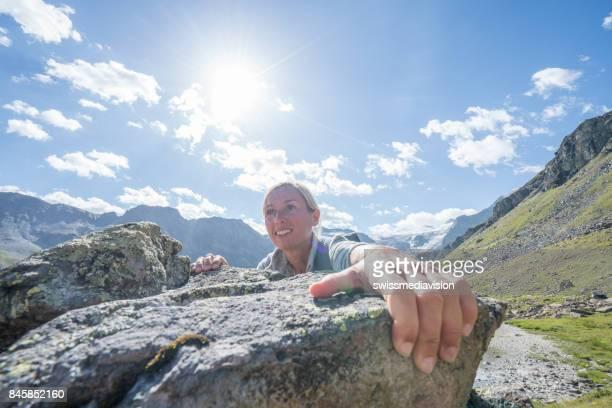 Young woman rock climbing in Switzerland