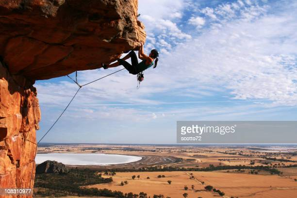 Young woman rock climbing in the desert