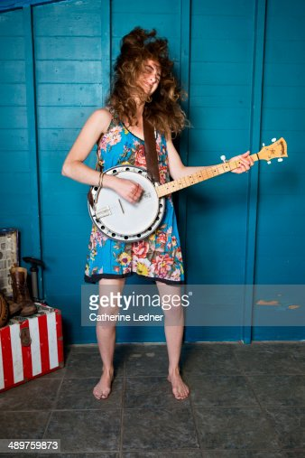 Young Woman Rocking Out with Banjo and Hair Flying