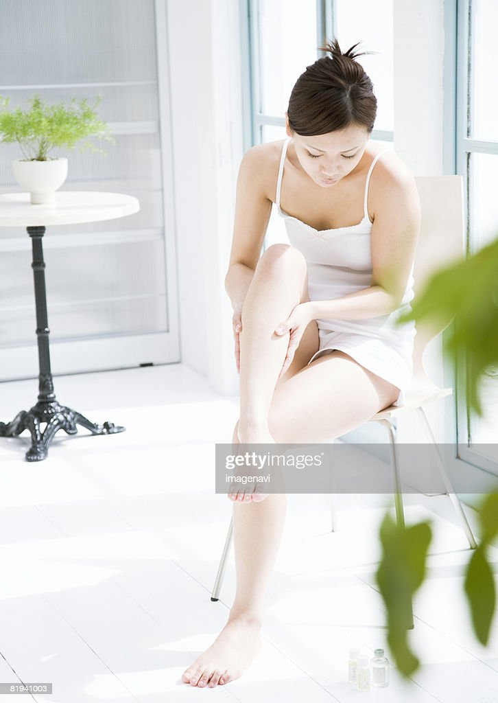 Young Woman Rubbing her Legs