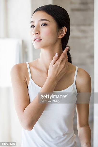 Young woman rubbing neck