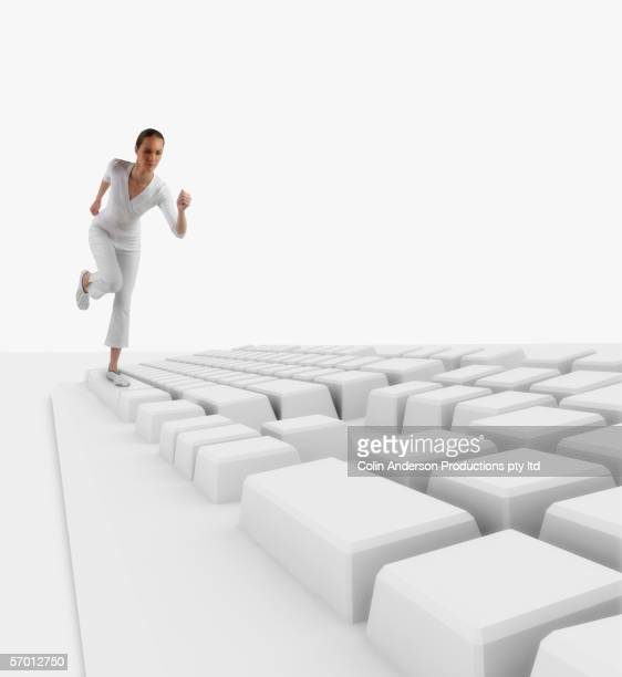 Young woman running across keyboard