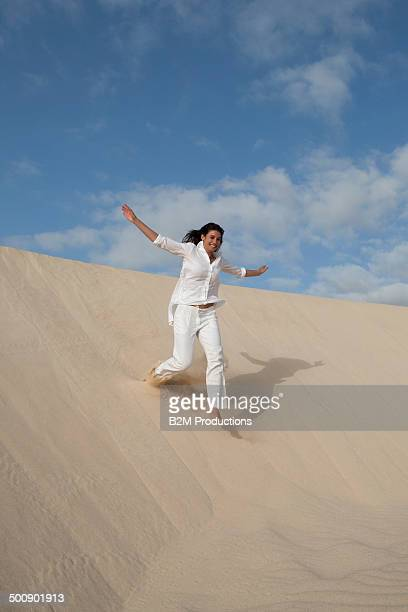 Young Woman Running In Desert