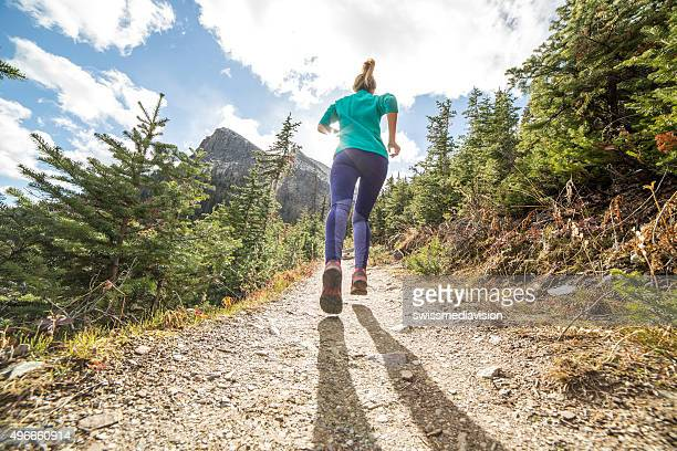 Young woman running in nature