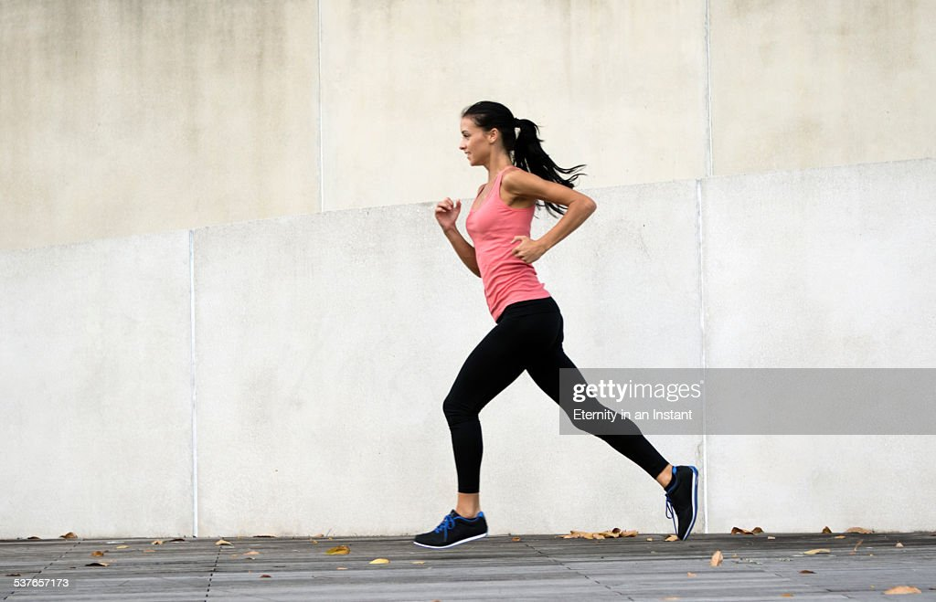 Young woman running in urban setting