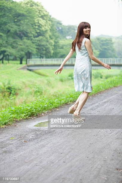 Young Woman Running on Footpath