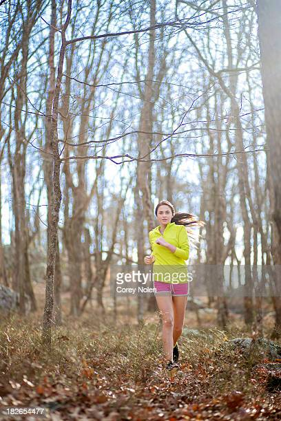 A young woman runs a trail at Cheaha State Park.