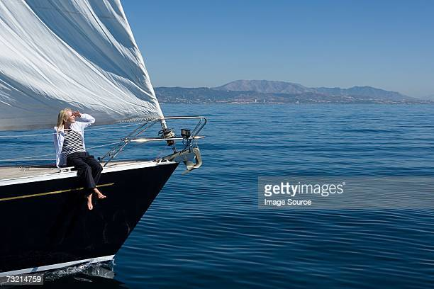 Young woman sat on sailboat