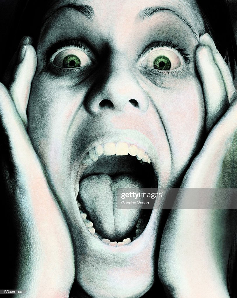 Young woman screaming, close-up (Digital Enhancement) : Stock Photo