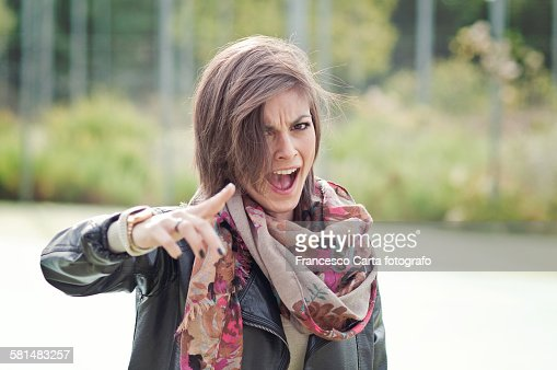 Young woman screaming : Stock Photo