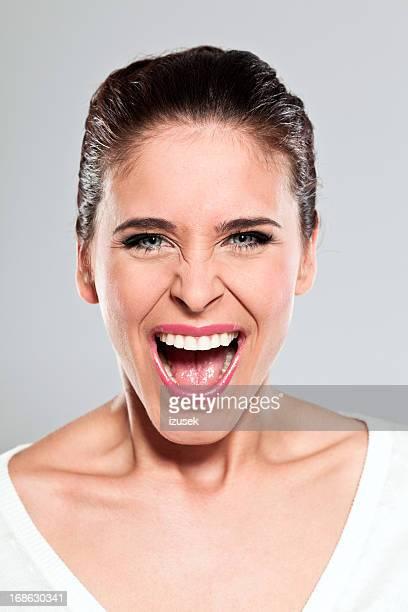 Young woman screaming, Studio Portrait