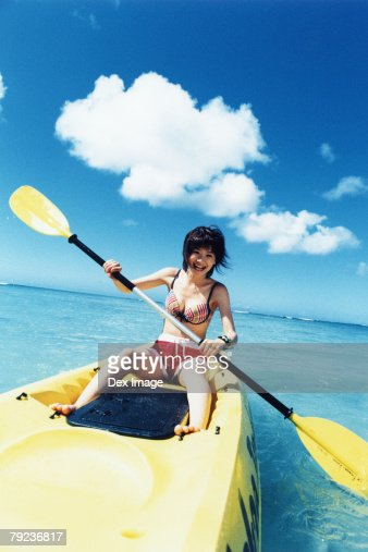 Young woman sea kayaking : Stock Photo