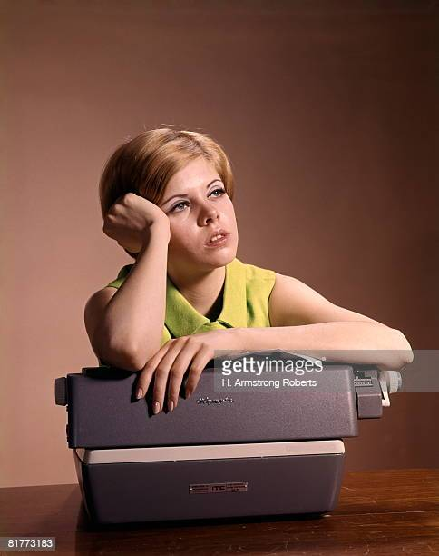 Young Woman Secretary Propping Up Head And Leaning On Typewriter Bored Daydreaming.